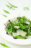 Rocket salad with parmesan — Stock Photo
