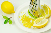 Lemon and lemon zest — Stock Photo