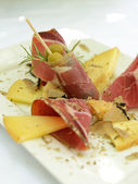 Prosciutto with cheese and truffle — Stock Photo
