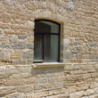A new window in the old wall — Stock Photo