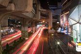 Under the bridge. Night City Roads. Blurred lights — Stock Photo