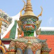 Green standing dragon. Fragment of King Palace in Bangkok — Stock Photo