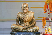 Golden statue of old Buddhist monk — Foto Stock