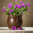 Beautiful still life with purple wild flowers on the table — Stock Photo