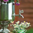 Chamomile tea cup. Still life with flowers and samovar — Stock Photo