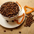 Cup of coffe with coffee beans — Stock Photo