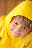 Cute little boy in yellow parka — Stock Photo