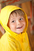 Cute little boy in yellow parka — Stock Photo