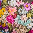 Macro of silk ribbon embroidery. Beautiful ribbon flower background — Stock Photo
