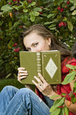 Beautiful girl with book — Stockfoto