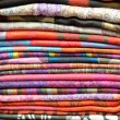 Pile of folded shawls, scarfs at the market — Stock Photo