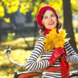 Stock Photo: Beautiful happy womsmiling in autumn park, having fun on sunny autumn day