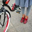Stock Photo: Retro bike and stylish woman. urbscene