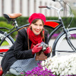 Smiling pretty woman with retro camera outdoors. Style beautiful girl taking pictures wearing red warm scarf, beret and gloves having fun playful laughing — Stok fotoğraf