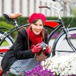 Smiling pretty woman with retro camera outdoors. Style beautiful girl taking pictures wearing red warm scarf, beret and gloves having fun playful laughing — Photo