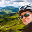 Joyful biker portrait in mountains — Stock Photo