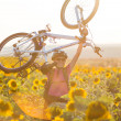 Young cyclist woman riding bicycle outdoors on a sunny day — Stok fotoğraf