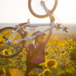 Young cyclist woman riding bicycle outdoors on a sunny day — Stockfoto