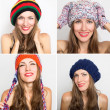 Happy young girl in different winter knitted caps  — Photo