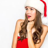Sexy woman wearing santa clause hat — Stock Photo