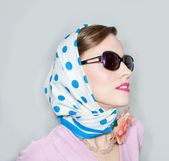 Fashion girl in retro scarf looking to the side — Stock Photo