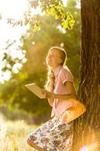 Tablet woman on a sunny day — Stock Photo