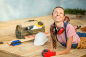 Happy woman builder relaxing after work — Stockfoto