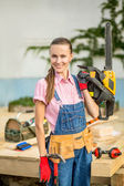 Woman builder with chain saw — Stock Photo