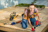Woman builder with construction tools — Stock Photo