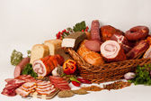 Smoked meat and sausages on white — Stock Photo
