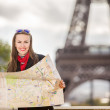Travel Paris Eiffel Tower woman happy tourist with map — Stock Photo #38952967