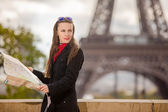 Travel Paris Eiffel Tower woman happy tourist with map — Stock Photo
