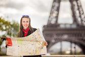 Travel Paris Eiffel Tower woman happy tourist with map — Stock Photo