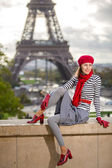 Paris woman by Eiffel tower — Stock Photo