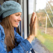 Young woman traveling by train — Stock Photo #39358333