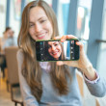 Woman using her smart phone — Stock Photo #39391853