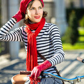 Retro woman and retro bike — Stock Photo