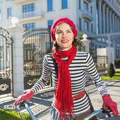 Woman and bike. Pretty woman on her bike — Stock Photo