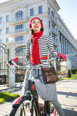 Happy tourist woman riding her bike — Stock Photo