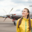 Young woman in front of the airplane — Stock Photo #39721493