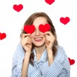 Stock Photo: Brunette girl with red hearts isolated on white