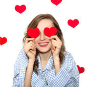 Brunette girl with red hearts isolated on white — Stock Photo