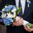 Stock Photo: Bridegroom with beautiful wedding flowers