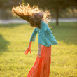 Happy young woman jumping — Stock Photo #40862463