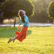 Happy young woman jumping — Stock Photo #40862477