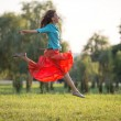 Happy young woman jumping — Stock Photo #40862499