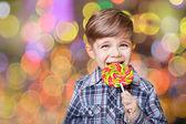 Boy having fun licking lollipop — Stock Photo