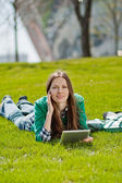 Young woman using tablet outdoor — Stock Photo