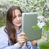 Beautiful woman with tablet computor — Stock Photo