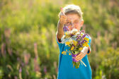The little boy with flowers — Stock Photo